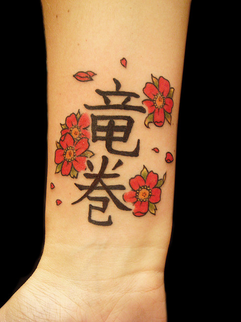 Japanese camellia flower tattoo for Small japanese tattoos