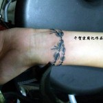 Ornamental bracelets tattoo on hand