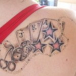 cards tattoo on shoulder